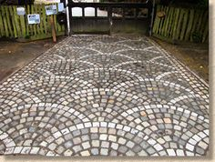 fan pattern setts -- if you love cobble patios, this website will blow you away.