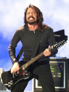 Google Image Result for http://cache2.allpostersimages.com/p/LRG/30/3010/937BF00Z/posters/dave-grohl-of-us-rock-band-foo-fighters-performs-on-the-main-stage-at-v-festival-in-hylands-park.jpg
