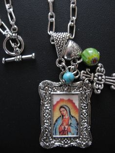 Our Lady of Guadalupe Necklace with Green Millefiore by jewelryrow, $22.00 https://www.etsy.com/listing/122472035/our-lady-of-guadalupe-necklace-with