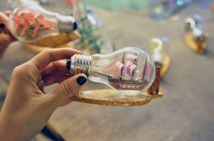 Tiny sail boat in a light bulb
