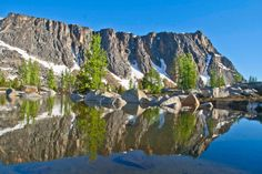 Amphitheater Mountain reflected in a snow melt pond, Upper Cathedral Basin, Pasayten Wilderness, Washington
