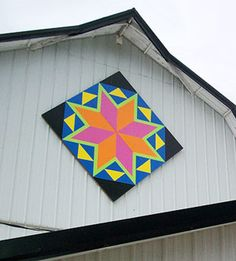 I like In Color Orders idea of barn quilts as large motif quilts. http://incolororder.blogspot.com/2011/08/giant-vintage-star-quilt.html