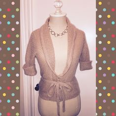 🌺FINAL PRICE! Pretty Short Sleeve Wrap Sweater🌺 This gorgeous sweater is a RePosh.  I love it but it runs very small.  Although it is marked as a medium if you want to button the sweater and use the wrap, you definitely need to be an extra small.  It fits very well on my mannequin.  Please see those measurements in my closet.  42% Wool, 33% Nylon, 25% Mohair.  Dry clean only. (149) Express Sweaters