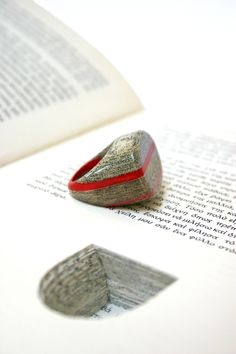 Jeremy May, Littelfy (literary jewels made with laminated paper removed from a book), serial no#: 085 - 'To Eikosietetraopo Mias Gynaikas'