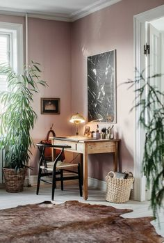 interior design ideas home office in muted pink tones with cowhide rug