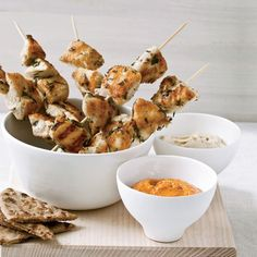 Herb-Marinated Chicken Skewers with Harissa | Andres Barrera briefly marinates chicken in herbs and cumin before skewering and grilling it; then he serves it with a cool chickpea puree and fiery harissa.