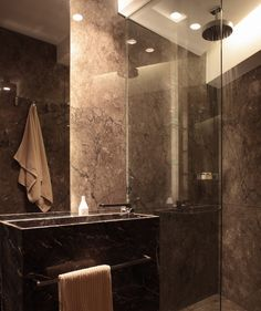 Bathroom in Dark Emperador marble by Belgian architects Co.Studio.