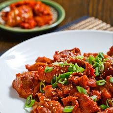 Daeji Bulgogi (Korean Spicy BBQ Pork) - top with tasted sesame seeds. Gochujang is a spicy, slightly sweet, beautiful dark red fermented chili paste, can find in the grocery store's Asian food section.