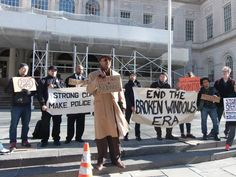Coalition to End Broken Windows members in front of City Hall, protesting NYPD Commissioner Bill Bratton's campaign for 1000 new officers