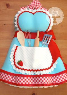 Retro pin-up apron cake for a kitchen tea-themed bridal shower. The cake is based on an apron by Dot's Diner. By The Royal Bakery
