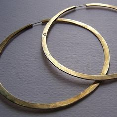 """These large brass hoops are classic and sexy. Hoops are 3"""" in diameter and lightly hammered to give a bit of texture. The continuous hoops have a sterling silver wire. Made in Argentina by Cynthia Del"""