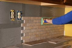 Ideal DIY home remodeling solution now available: tile adhesive on a roll  - Peel and Stick