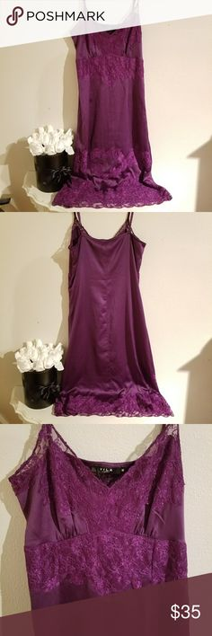 A Vila Clothes purple dress NWT. This is a beautiful silky purple dress. The lace provides gorgeous detail. It is long and hits about mid-range. VILA Dresses Midi