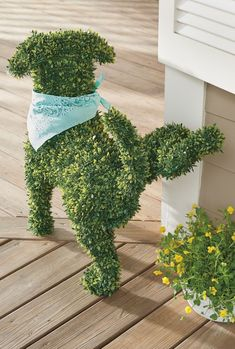 You don't need a country estate or master gardener to enjoy the everlasting charm of our Peabody Faux Boxwood Garden Dog. She doesn't require grooming or water, and never barks! A simple and playful way to fetch smile after smile in the garden, at an entryway, or nearly anywhere in your landscape.