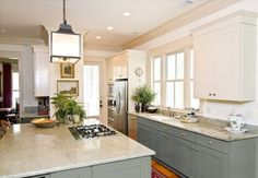 25 Glamorous Gray Kitchens. Like the countertop with the light greige cabinets.