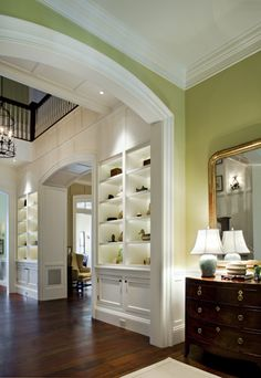 Love the woodwork, the shelves, the arch and crown moldings!