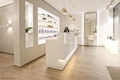 Designated checkout area with lighted product bar with this checkout person knowledgeable About product would be great Hair Salon Interior, Nail Salon Decor, Beauty Salon Decor, Beauty Salon Design, Medical Office Design, Pharmacy Design, Clinic Interior Design, Clinic Design, Spa Room Ideas Estheticians