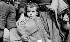 Black and white photo of a boy holding a blanket