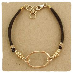 Don't like the mddle circle but maybe a wire wrapped stone would look good.