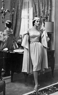 1957 Model in elegant dinner ensemble of sky-blue crêpe, the dress is softly draped hugging the figure under a loose fitting coat of same material, by Jean Patou