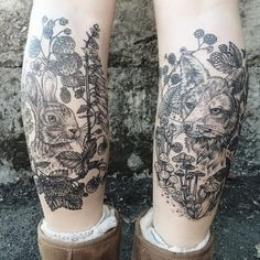 Black and white engraving style black ink legs tattoo of rabbit with fox and…