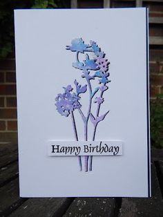 handmade birthday card from Craft-E-Place ,,, clean and simple ,,, die cut wildfowers ... watercolored in blue and lavender ...