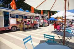 Philadelphia, PA -The Oval, a new outdoor oasis on the parkway welcomes some of the city's best food trucks and a beer garden! (Photo by M. Fischetti) NIce to see the attractive tables and chairs making this food truck festival a really comfortable destination!