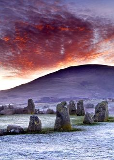 A very hard frost had occurred overnight turning the ground white with rime. Then as the sun rose, the thin layer of Stratocumulus cloud that was sitting over Blencathra exploded into a fiery sea of colour. Fire and Ice - a perfect combination. Castlerigg Stone Circle. Alan Novelli