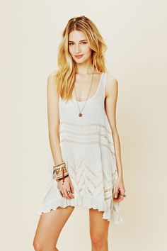 Voile and Lace Trapeze Slip   Sheer dotted slip dress with lace inset throughout. Ruffled hem.