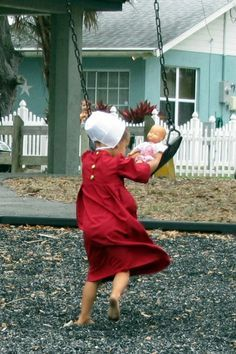 A little Amish girl putting her doll on a swing. Children are not born selfish. they learn it from grownups. Isadora Duncan, Pumpkin Face, Stem Challenge, Amish Family, Amish Culture, Amish Community, Pennsylvania Dutch, Amish Country, We Are The World