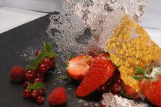 Fresh berries with gold and silver Tuiles
