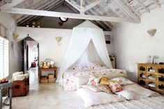 bedroom / attic / white grey pink / light / chest / rustic vintage / mosquito net canopy / cabinet / pillows / floral ornaments / attic / wood / decor / details