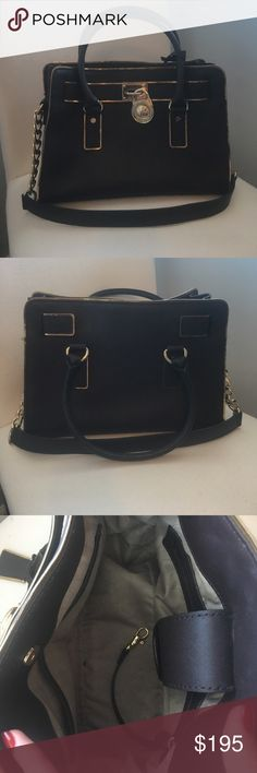 Michael Kors brown and gold medium sized bag Almost perfect condition brown and gold MK bag with gold chain strap and three inside pockets. Leather is in near perfect condition just slight wear. Michael Kors Bags Totes