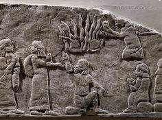 ANTIQUITIES ORIENTAL: ASSUR RELIEF 10TH-6TH BCE Warriors in camp lighting fire. Stone bas-relief (7th BCE) from the palace of Ashurbanipal in Niniveh, Mesopotamia (Iraq). British Museum, London, Great Britain