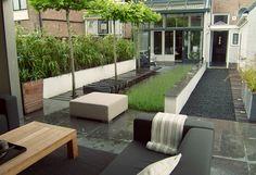 www.buytengewoon.nl. tuinontwerp - tuinaanleg - tuinonderhoud. Prachtige achtertuin in centrum van Kampen. Met zinken veranda, sfeervolle waterpartij en gestuukte elementen. www.buytengewoon.nl