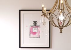 The charm of vintage perfume bottles is enhanced by subtle washes of color—in pink, of course—in Rosé, a lovely piece by artist Natasha Marie. The gicleé watercolor print is loosely rendered and features black pen line detailing. Framed by hand in our own U.S. workshops.