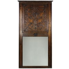 1stdibs | A Large French Finely Carved Walnut Trumeau Mirror