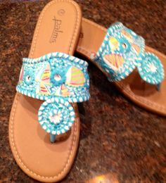 Hand painted sandals in the look if you gotta regatta . Lilly Pulitzer like print in the style if Jack Rogers !! Get yours at www.etsy.com shop name is Luckyleaf