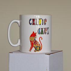 Celtic Cat Mug in Orange by WEatonMedievalArts on Etsy Cat Mug, Celtic, Mugs, Orange, Unique Jewelry, Handmade Gifts, Artwork, Etsy, Vintage