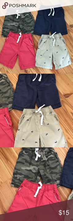 Carter's Shorts Bundle Four pair Carter's shorts. Navy, Khaki with navy blue whales, camo, watermelon color. See photo with stain and rip that was hand stitched on the watermelon color shorts. Dark stain on back of left leg of navy shorts. All others good condition. Size 5 Carter's Bottoms Shorts