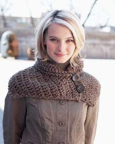 Warm, stylish buttoned scarf keeps your neck warm. Shown in Bernat Roving.