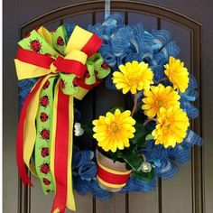 """Yellow Gerbera Daisy Wreath Kit - Assembly Required Supplies Included in Kit: XX750469 Sky Blue 24"""" Pencil Wreath FX181829 Potted Yellow Gerbera Daisy XB96410-05 Denim/Ivory Poly"""
