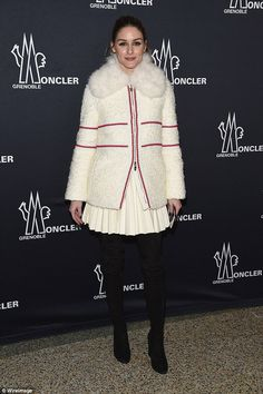 Fashion savvy:The former reality TV star decided to go for a monchrome look, wearing black jeans, and a bold white jacket with a lining of fur around her neck