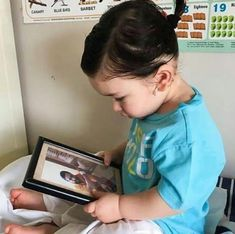 Taimur Ali Khan is internet favourite star kid. Here is another adorable picture where Taimur is seen staring at his papa Saif Ali Khan picture. Celebrity Faces, Celebrity Kids, Celebrity Pictures, Taimur Ali Khan, Saif Ali Khan, Very Cute Baby, Cute Little Baby, Vintage Bollywood, Bollywood News