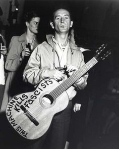 I have a t-shirt that says the same thing, only over a mixer.  I love Woody Guthrie's music and what he stood for – the value of real people.