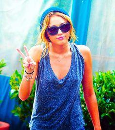 Miley Cyrus. Hat. Glasses. Shirt. Hair.