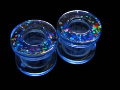 pale blue tunnel plugs with holographic confetti pattern