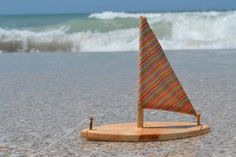 Sailboat Handcrafted out of solid pine with a colorful sail, this boat has a beeswax/jojoba oil finish and is water ready. Your captain will have Water Animals, My Son Birthday, Solid Pine, Color Stripes, Dremel, Beach Photos, Photography Props, Antique Items, Wonders Of The World