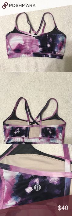 Lululemon patterned sports bra 💜 Lululemon sports bra in excellent used condition: printed in various shades of purple and white, has small black mesh panels where the straps begin in the front, no padding, cross-cross back, size 8! lululemon athletica Intimates & Sleepwear Bras