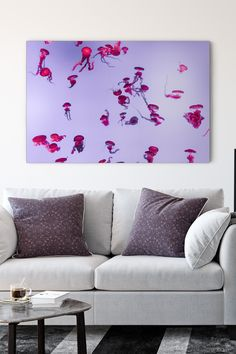 These tiny silly jellyfishes seem to have a party. Chilling in their private aquarium, they look luxurious and stylish.  Did you know, that touch of some types of jellyfishes can be fatal for a human? Although, these majestic marine animals don't purposely attack humans. Most stings occur when people accidentally touch a jellyfish.  This amazing canvas art print is ideal for minimalist modern interiors. Buy it and add bright spots to your living room. Types Of Jellyfish, Jellyfish Art, Color Of The Year, Home Look, Modern Minimalist, Chilling, Deep Purple, Canvas Art Prints, Ultra Violet